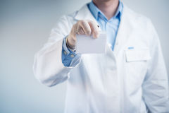 Scientist or medical doctor shows id Royalty Free Stock Images