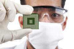 Scientist with a microchip computer Royalty Free Stock Photo