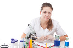 Scientist and microscope. In laboratory royalty free stock photography