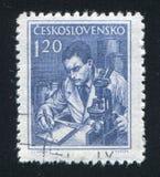 Scientist and microscope. CZECHOSLOVAKIA - CIRCA 1954: stamp printed by Czechoslovakia, shows Scientist and microscope, circa 1954 Royalty Free Stock Image