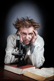 Scientist with microscope Royalty Free Stock Photography