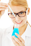 Scientist Mixing Chemical In Beaker Stock Images