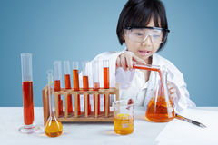 Scientist mixing the chemical fluid Stock Photo