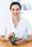 Scientist mixing herbs with pestle and mortar Stock Photos
