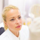 Scientist observing petri dish. Royalty Free Stock Photo