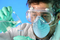 Scientist Pertofrming Experiment Stock Photo