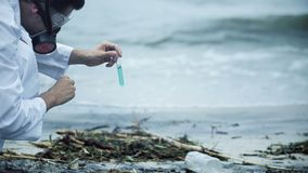 Scientist pessimistic about water test result, health issues caused by pollution. Stock footage stock footage