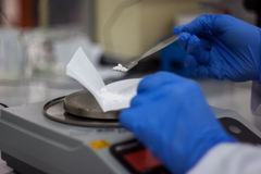 Scientist phd student taking from balance scale DNA samples from stock images