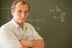 Scientist pose on background of blackboard Royalty Free Stock Photos