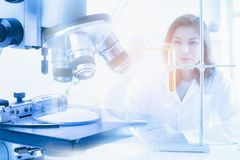 Scientist pour liquid into test tube stock image