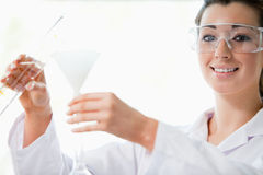 Scientist pouring liquid with a funnel Stock Photos