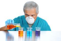 Scientist Pouring Liquids into Beakers Stock Image