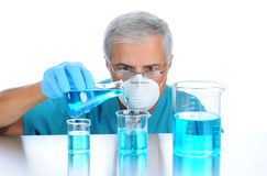 Scientist Pouring Liquids into Beakers Royalty Free Stock Photography