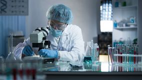 Scientist preparing workplace for studying dna branches for cloning process stock images