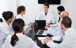 Scientist presenting report during working meeting royalty free stock photos