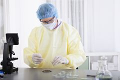 Scientist in protective gear with blood sample Royalty Free Stock Photography