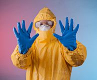 Scientist with protective hazmat suit Royalty Free Stock Image