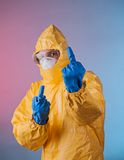 Scientist with protective hazmat suit Stock Image
