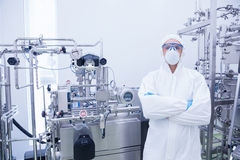 Scientist in protective suit standing with arms crossed Royalty Free Stock Images