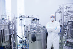 Scientist in protective suit standing with arms crossed Stock Images
