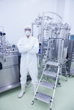 Scientist in protective suit standing with arms crossed Royalty Free Stock Image