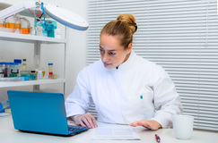 Scientist reads papers on computer in the lab Stock Images