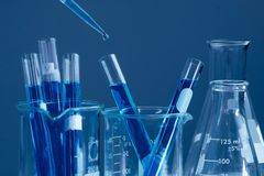 Scientist research chemistry at science lab. Test tubes closeup, science laboratory research and development concept Royalty Free Stock Photos