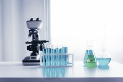 Scientist research laboratory equipment tools in Lab room secure., Microscope and testing beakers on a tabletop., Technology of stock photos