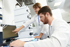Scientist researcher team works in laboratory Stock Photography