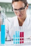 Scientist researcher using a pipette and test tubes Royalty Free Stock Images