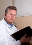 Scientist researches test results Royalty Free Stock Image