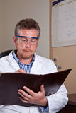 Scientist researches test results Royalty Free Stock Photos