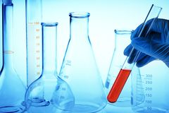 Scientist's hand holding test tube Royalty Free Stock Photos