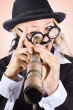 Scientist searching for a cure with telecope. Medical scientist close to finding a cure when searching through the end of a telescope. Breakthrough concept Royalty Free Stock Photography