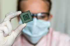 Scientist showing the computer microchip before repairs electron Royalty Free Stock Images