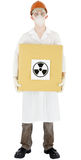 Scientist and sign radiation. Scientist holding carton box with sticker sign radiation Royalty Free Stock Images