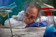 Scientist sleeping on lab desk Royalty Free Stock Photos