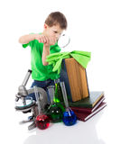 Scientist small boy looking through magnifying glass royalty free stock photo
