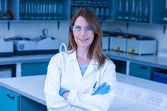 Scientist smiling at the camera in lab Stock Images