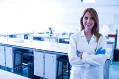 Scientist smiling at the camera in lab Royalty Free Stock Photography