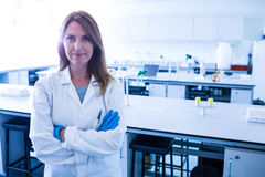 Scientist smiling at the camera in lab Royalty Free Stock Image