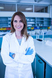 Scientist smiling at the camera in lab Stock Photography