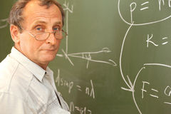 Scientist solves equation on blackboard Stock Photos