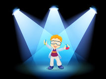 A scientist at the stage with spotlights Royalty Free Stock Photo