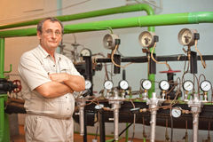 Scientist stand near pipes with meters Royalty Free Stock Photo