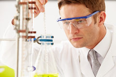 Scientist Studying Liquid In Flask Stock Photos