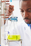Scientist Studying Liquid In Flask Stock Photography