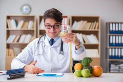 The scientist studying nutrition in various food Royalty Free Stock Photos