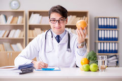 The scientist studying nutrition in various food Royalty Free Stock Photo