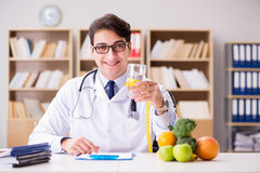 The scientist studying nutrition in various food Royalty Free Stock Image